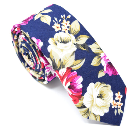 Navy blue skinny tie with large floral pattern.