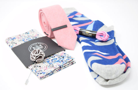 Pre-styled box with pink and blue accents. Kings Stay Kings boxes feature a pocket square, lapel pin, tie, tie bar, shoe laces, and socks.