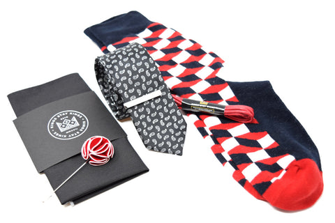 Kings Stay Kings pre-styled box featuring a pocket square, lapel pin, tie, tie bar, shoe laces, and socks.
