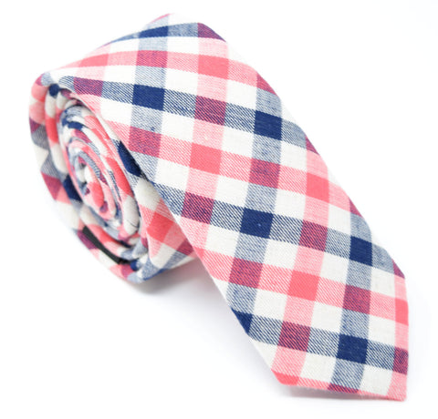 Checkmate tie is handmade and has a white, navy, and red plaid pattern.