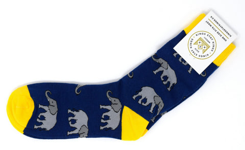 navy and yellow socks with grey elephants.