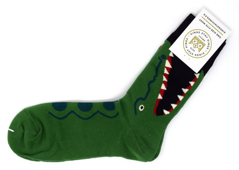 green and black socks with a large alligator.