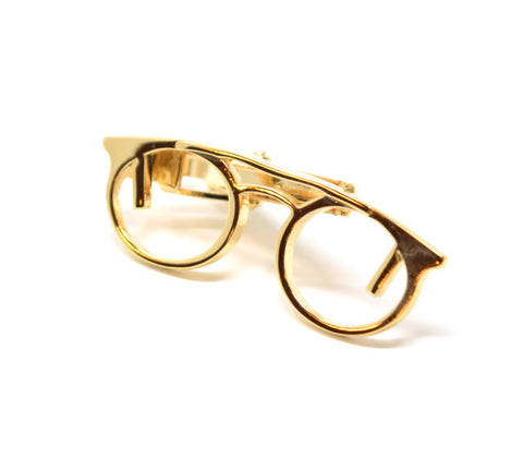Polished gold glasses tie clip.