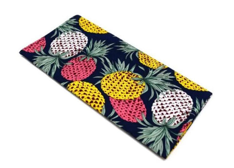 Navy pocket square with a variety of coloured pineapples.