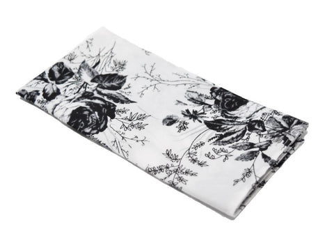 Goodfella is a white pocket square with a black floral pattern.