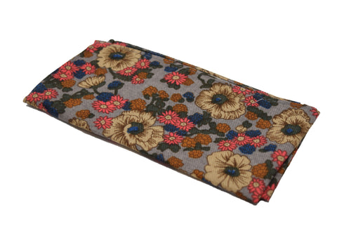 The Centrepiece is a floral pocket square featuring fall colours.