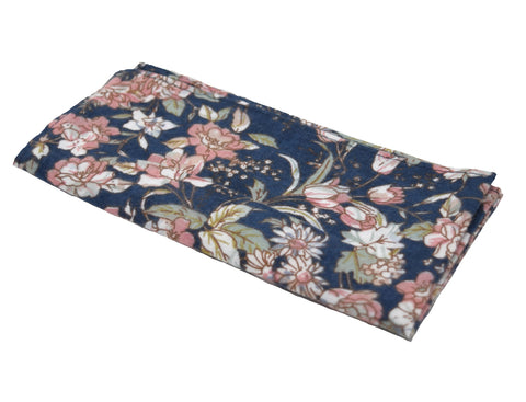 Swipe Right is a blue pocket square with a light, dusty-rose floral pattern.
