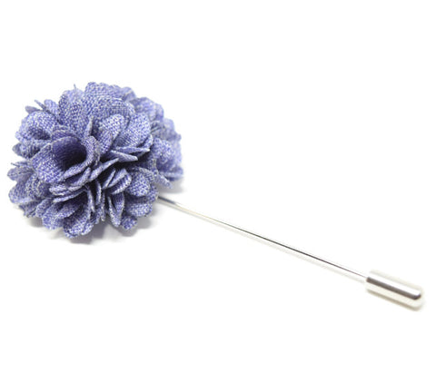 Purple flower lapel pin for a suit.