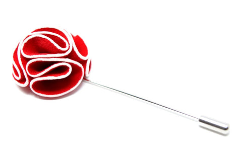 Red and white flower lapel pin.