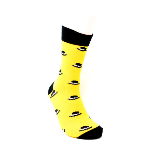 Yellow sock with black top hats.
