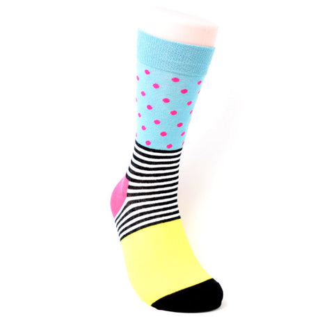 Colours on this sock include yellow, pink, black and white stripes, teal with pink polka dots.