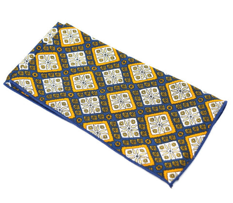 Rich Mahogany is a navy pocket square with gold and white diamond shaped accents.