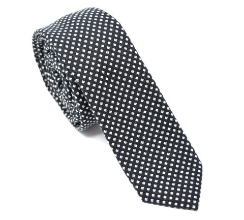 Black tie with small white polka dots.