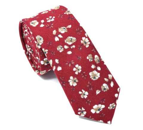 Red tie with floral pattern.