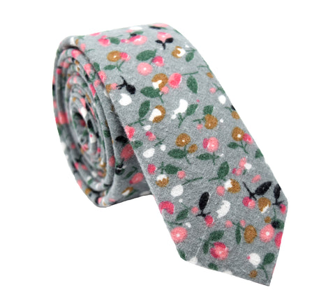 "Grey tie with small floral pattern featuring pink, black, white, brown, and green colours. This is a 2.5"" (5cm) skinny tie"