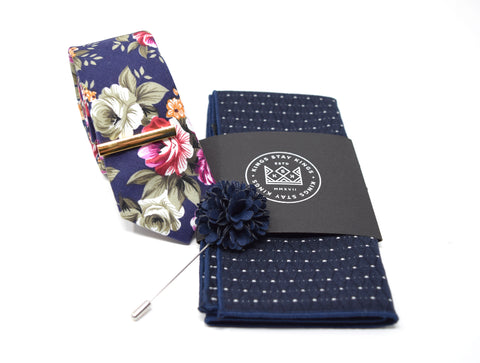 This pre-styled box comes with our most popular floral tie, gold tie bar, navy with white marking pocket square, and navy flower lapel pin.