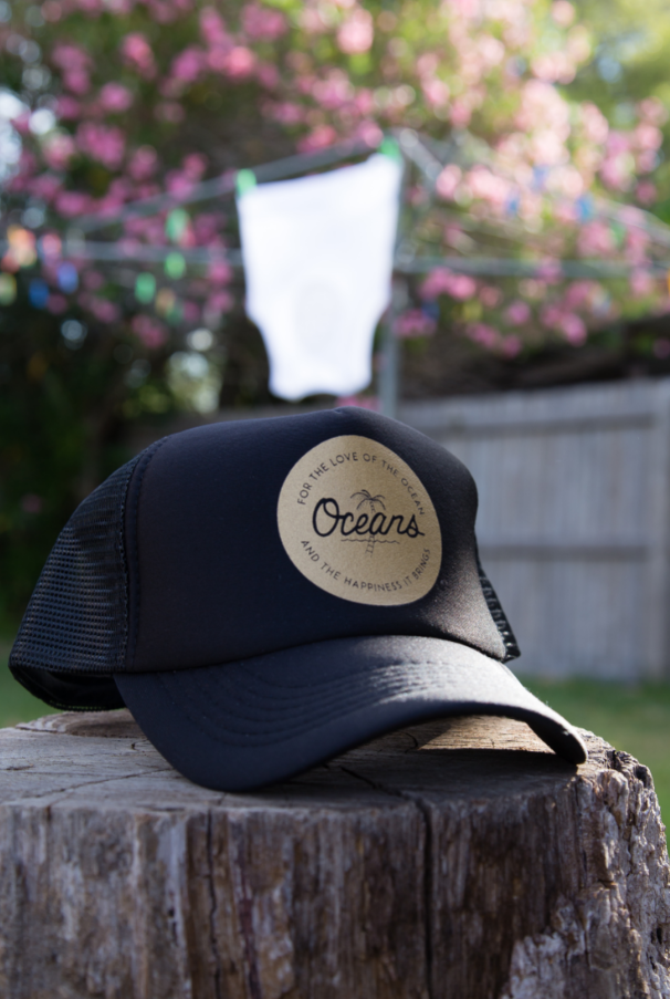 oceans of love and happiness black gold print cap