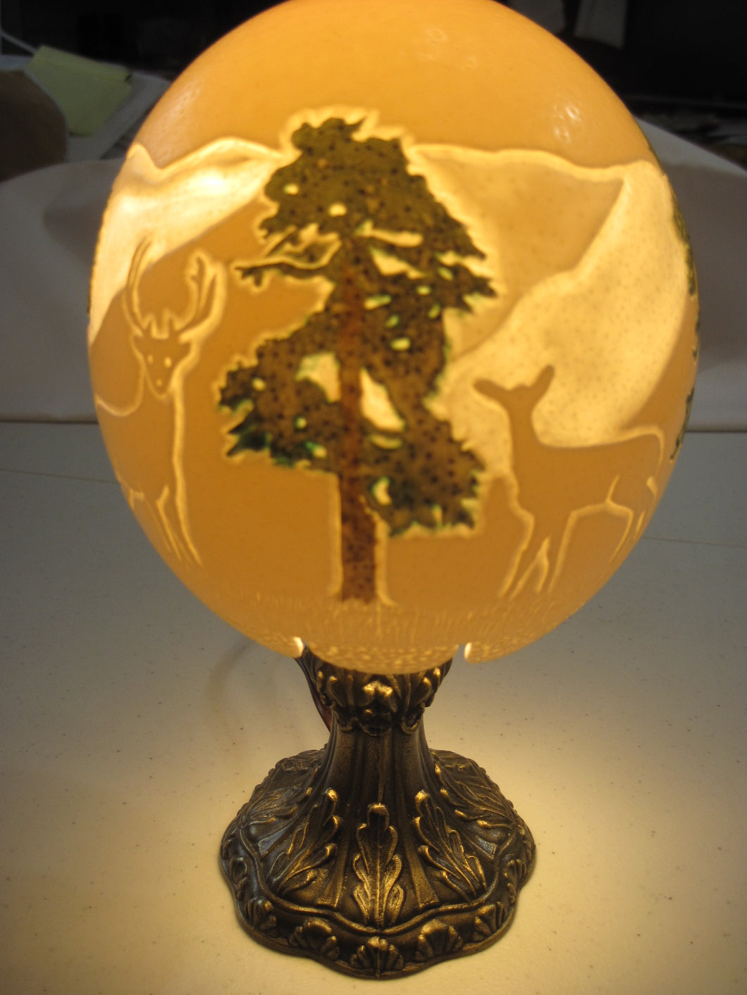 Table Lamp with an Ostrich Egg Shade carved with mountains and deer