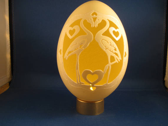 Carved Rhea Egg Swans and Hearts mounted to a battery operated tea-light.