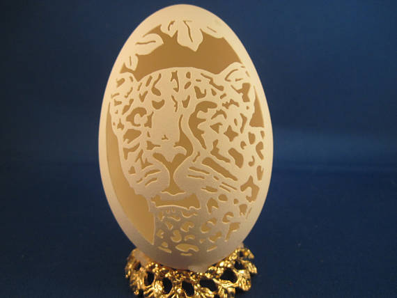 Tiger carved on a Goose Egg with clear plastic stand. Great for A Wild Animal Lovers Gift.