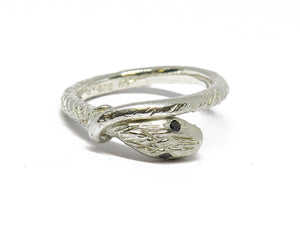 Silver snake ring with black eyes