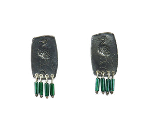 Bird impression studs with green fringe