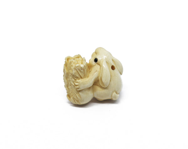 Vintage ivory bunny with cabbage ojime bead