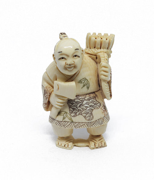 Vintage ivory man with axe netsuke