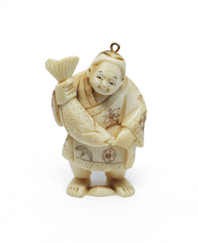 Vintage ivory man with fish netsuke
