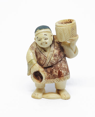 Vintage ivory man with basket netsuke