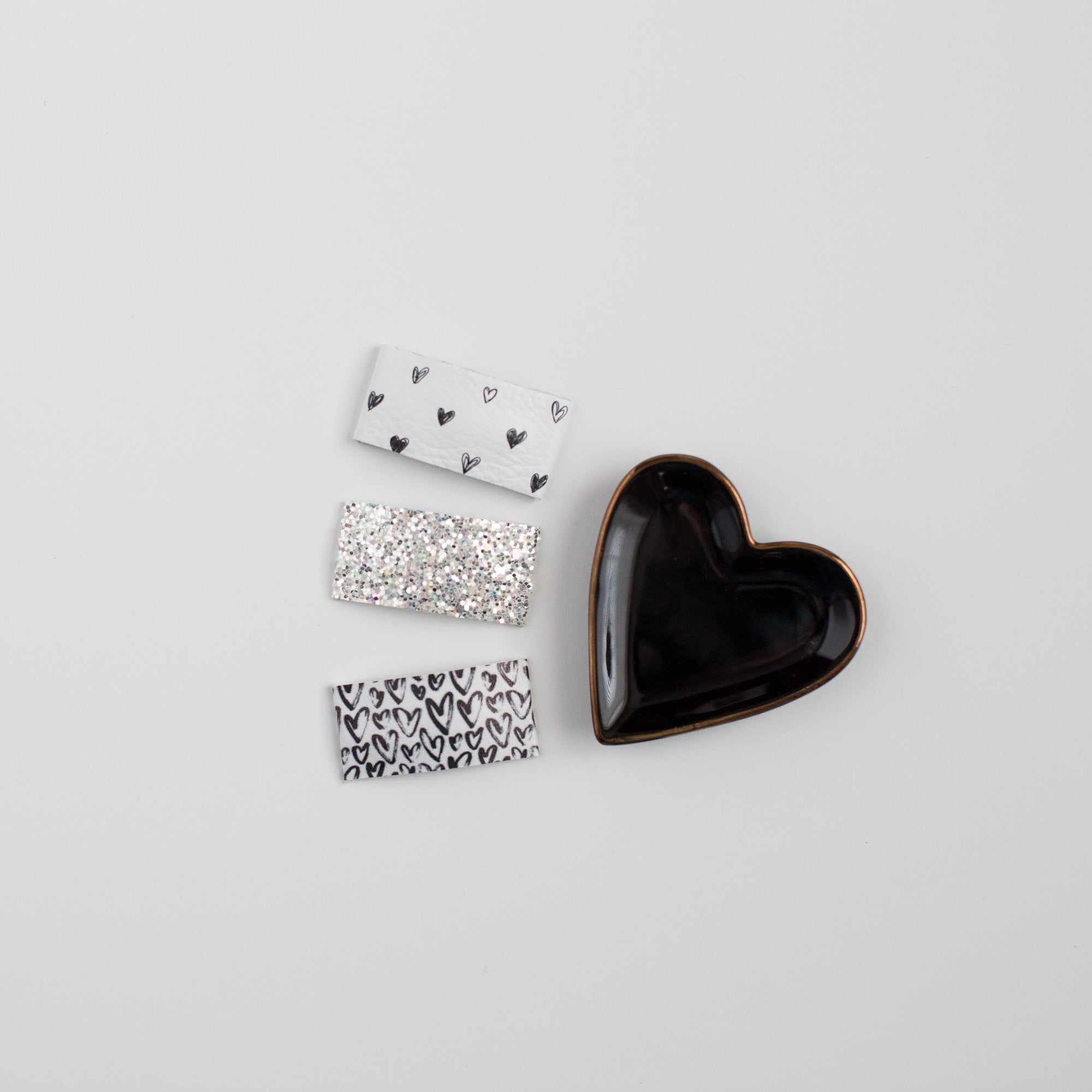 Monochrome Hearts Faux Leather Printed Snap Clip