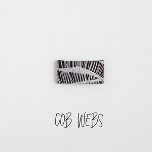 Cobwebs Leather Snap Clip