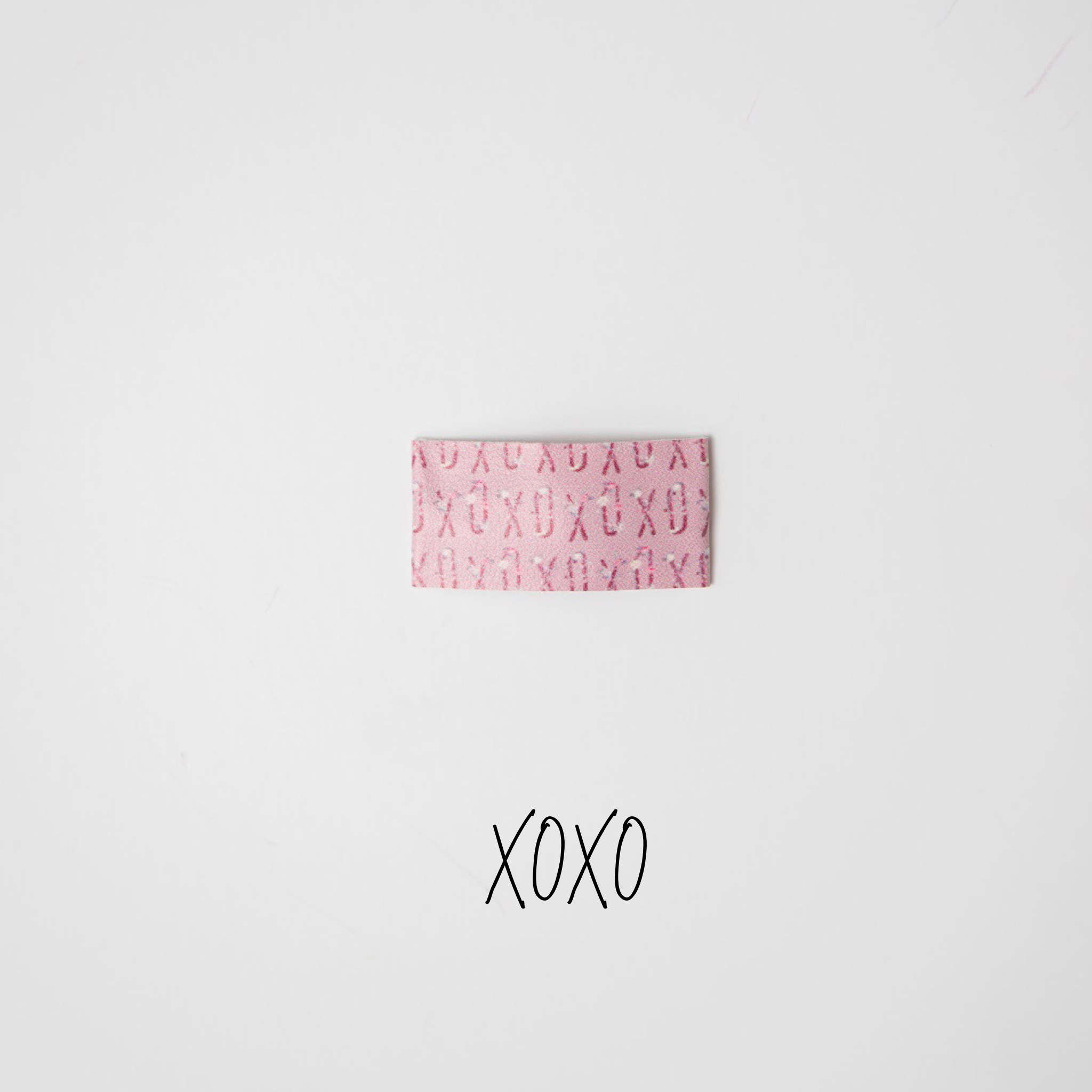 XOXO Faux Leather Printed Snap Clip