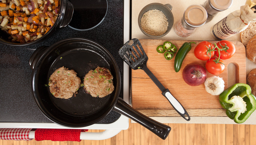 two turkey burgers in skillet