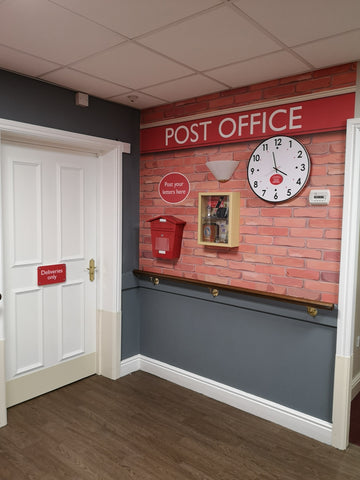 Care home mural of a Post Office with a clock, post box and memory box with stamps and money