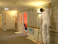 Cafe wallpaper mural designed for dementia care being installed in a Care Home