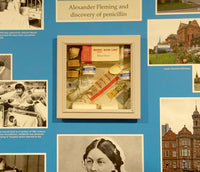 Reminiscence display artwork featuring a medical memory box and images relating to hospitals nurses and the NHS images