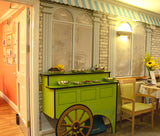 Wallpaper mural of a Cafe designed for dementia care homes featuring a market barrow with finger food