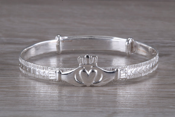 Child's expanding Claddagh bangle, sterling silver and measures 45 mm round and can be extended,perfect gift solution