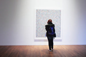Woman looking at picture in a gallery