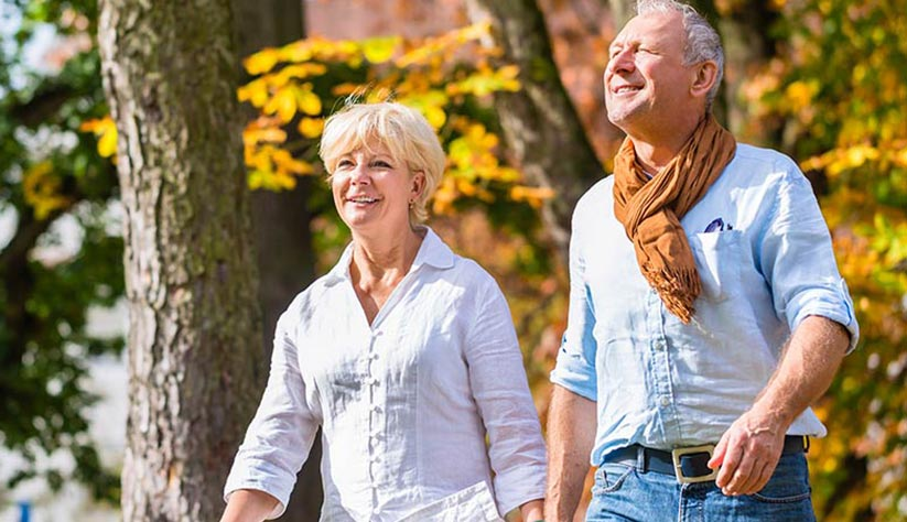 Elderly man and woman walking in the park