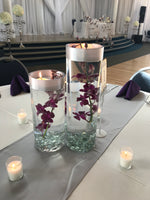 3 cylinder centerpiece with flower and floating candle