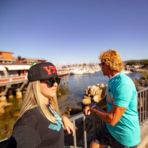 Image of vxii v12 lifestyle mens hats rosso fantastico on the pier