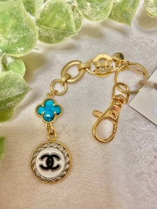 Vintage Chanel Gold Keychain with White/Black Button and Teal Charm