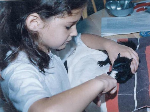 a young samantha shorkey feeding an orphaned baby squirrel