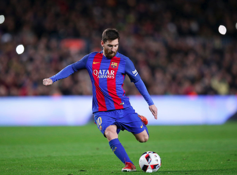 Lionel Messi kicking soccerball