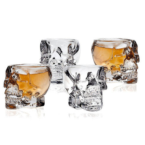 Set of four 2.5oz glass skull shot glasses.