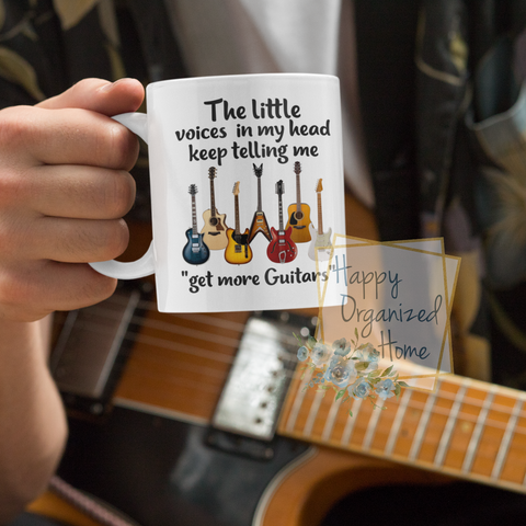 "The little  voices in my head keep telling me to ""get more guitars"" coffee mug"