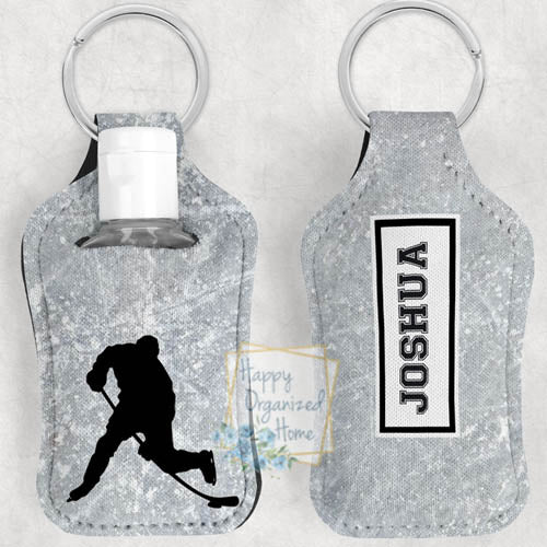 Hockey Personalized Hand Sanitizer Holder Key chain. Includes plastic refillable Bottle.