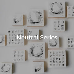 Series of minimal abstract artwork in neutral tones in a grouping